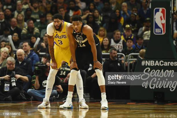 Anthony Davis of the Los Angeles Lakers and Giannis Antetokounmpo of the Milwaukee Bucks wait for a free throw during a game at Fiserv Forum on...