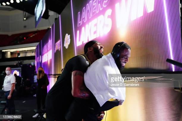 Anthony Davis of the Los Angeles Lakers and LeBron James of the Los Angeles Lakers celebrate after a game against the Denver Nuggets during Game Two...