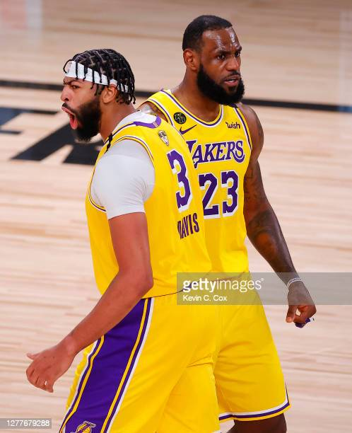 Anthony Davis of the Los Angeles Lakers and LeBron James of the Los Angeles Lakers react to his rebound and basket during the third quarter against...