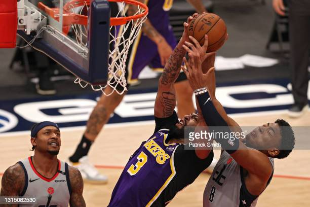 Anthony Davis of the Los Angeles Lakers and Rui Hachimura of the Washington Wizards battle for a rebound during the second half at Capital One Arena...