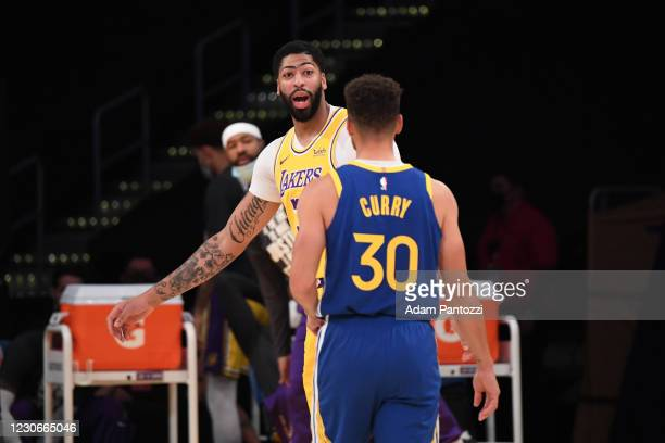 Anthony Davis of the Los Angeles Lakers and Stephen Curry of the Golden State Warriors talk during the game on January 18, 2021 at STAPLES Center in...