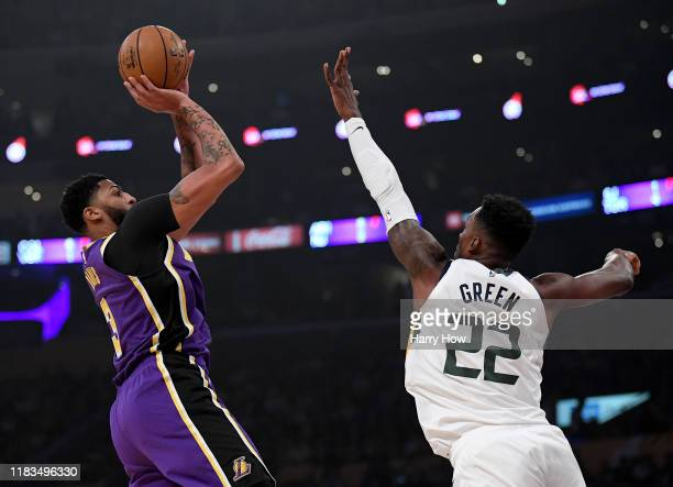 Anthony Davis of the Los Angeles Lakers attempts a fade away jumper in front of Jeff Green of the Utah Jazz during the first half at Staples Center...