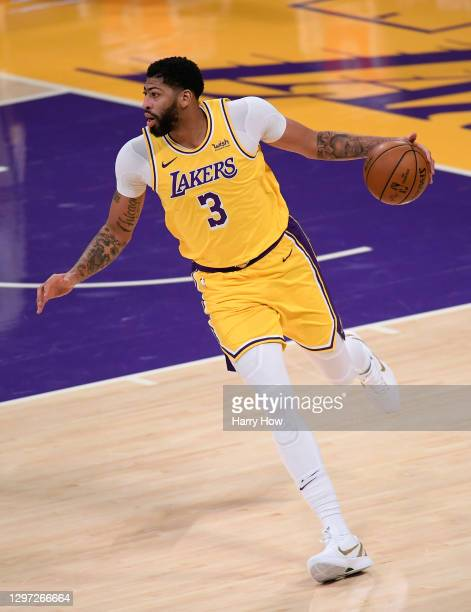 Anthony Davis of the Los Angeles Lakers carries the ball during a 115-113 loss to the Golden State Warriors on Martin Luther King Jr. Day at Staples...