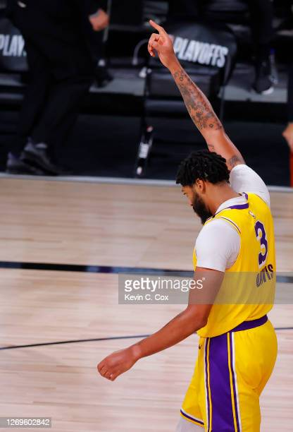 Anthony Davis of the Los Angeles Lakers celebrates a dunk against the Portland Trail Blazers during the fourth quarter in Game Five of the Western...
