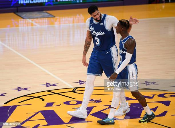 Anthony Davis of the Los Angeles Lakers celebrates a lead over the Denver Nuggets with Dennis Schroder after a timeout during a 114-93 Lakers win at...