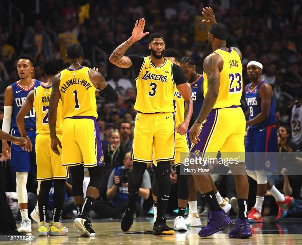 Anthony Davis of the Los Angeles Lakers celebrates his basket and foul with LeBron James during the first half in the LA Clippers season home opener...
