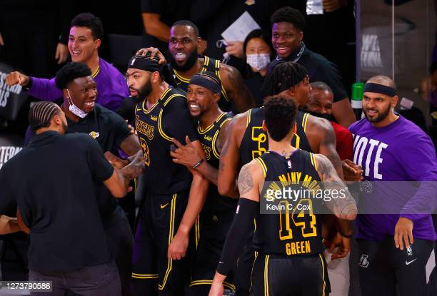 Anthony Davis of the Los Angeles Lakers celebrates with his temamates after shooting a three point basket to win the game over Denver Nuggets in Game...
