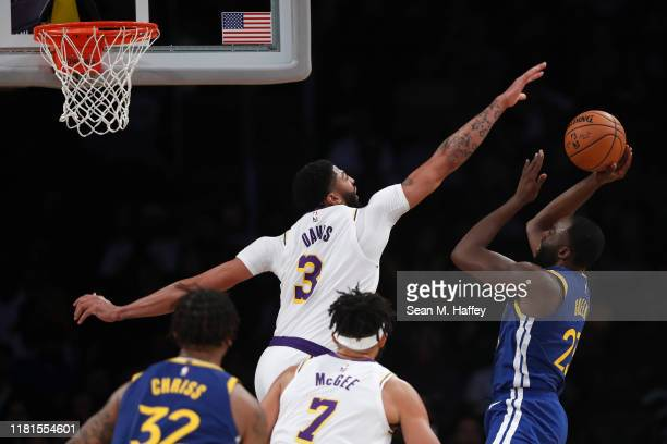 Anthony Davis of the Los Angeles Lakers defends against a shot by Draymond Green of the Golden State Warriors during the second half of a game...