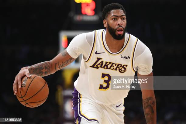 Anthony Davis of the Los Angeles Lakers dribbles the ball during the second half of a game against the Golden State Warriors t Staples Center on...