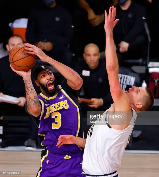 Anthony Davis of the Los Angeles Lakers drives the ball against Nikola Jokic of the Denver Nuggets during the third quarter in Game Five of the...