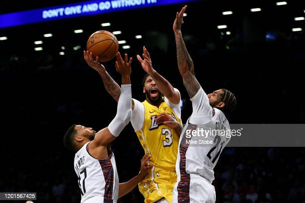 Anthony Davis of the Los Angeles Lakers drives to the basket against Wilson Chandler and Garrett Temple of the Brooklyn Nets at Barclays Center on...