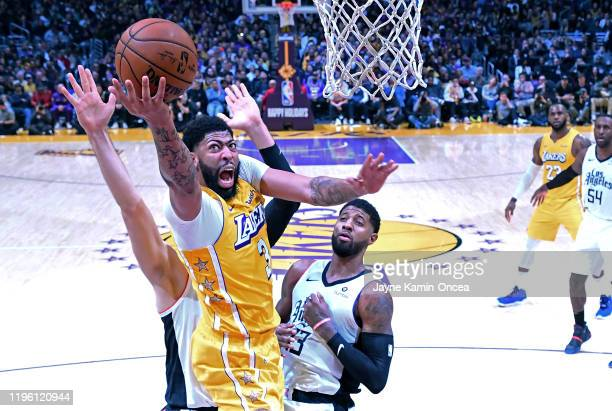 Anthony Davis of the Los Angeles Lakers drives to the basket between Ivica Zubac and Paul George of the Los Angeles Clippers in the game at Staples...