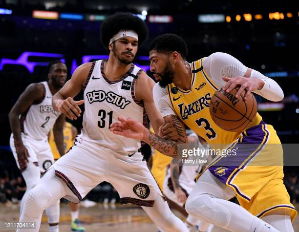 Anthony Davis of the Los Angeles Lakers drives to the basket on Jarrett Allen of the Brooklyn Nets during a 104102 Nets win at Staples Center on...