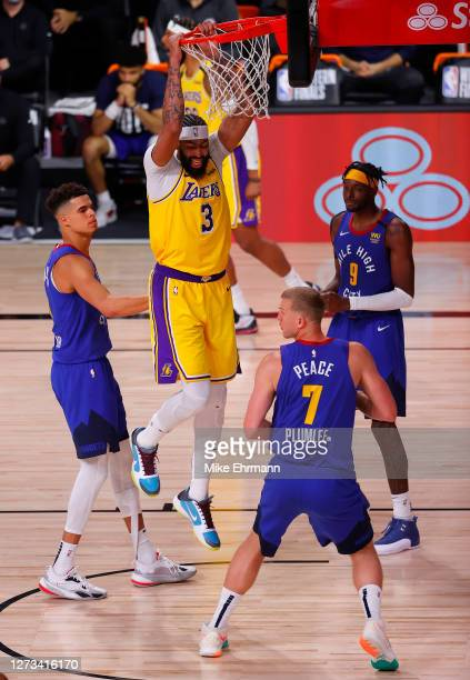Anthony Davis of the Los Angeles Lakers dunks against the Denver Nuggets during the fourth quarter in Game One of the Western Conference Finals...