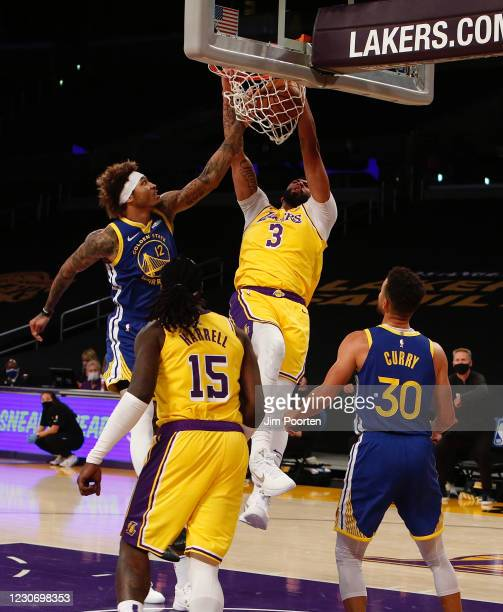 Anthony Davis of the Los Angeles Lakers dunks against the Golden State Warriors on January 18, 2021 at STAPLES Center in Los Angeles, California....