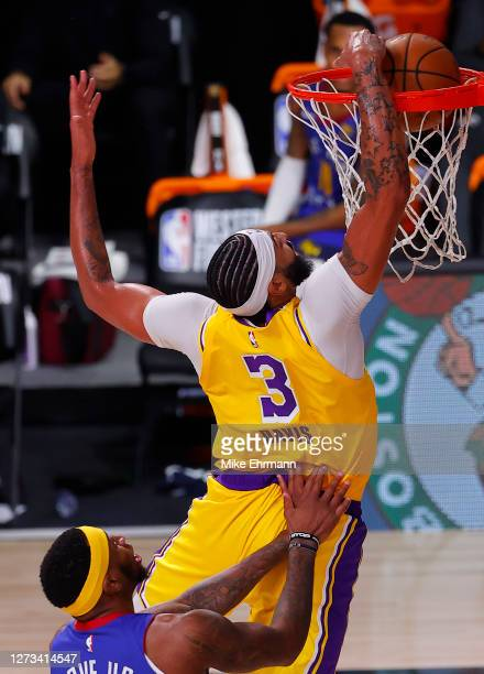Anthony Davis of the Los Angeles Lakers dunks against Torrey Craig of the Denver Nuggets during the third quarter in Game One of the Western...