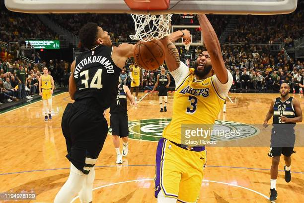 Anthony Davis of the Los Angeles Lakers dunks over Giannis Antetokounmpo of the Milwaukee Bucks during the second half of a game at Fiserv Forum on...