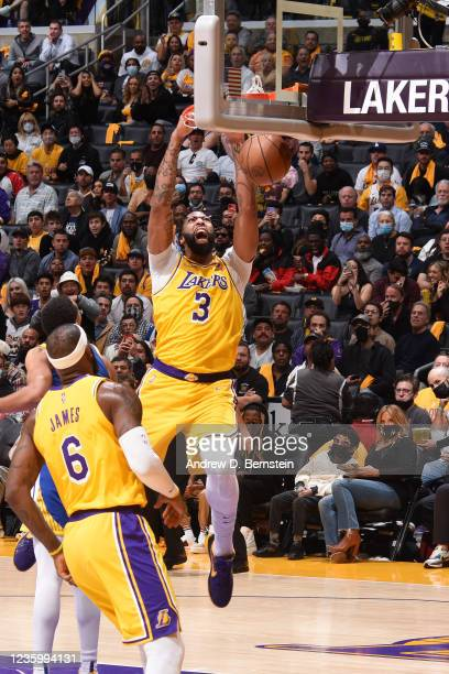 Anthony Davis of the Los Angeles Lakers dunks the ball against the Golden State Warriors on October 19, 2021 at STAPLES Center in Los Angeles,...