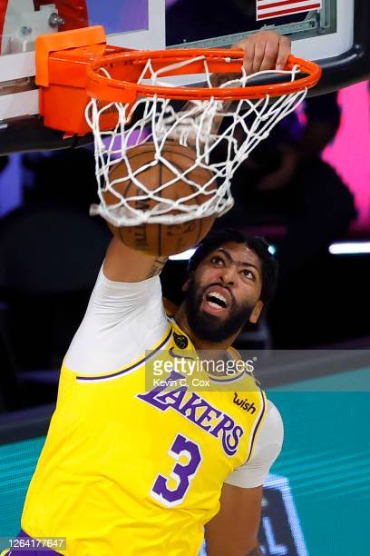 Anthony Davis of the Los Angeles Lakers dunks the ball against the Oklahoma City Thunder during the first quarter at HP Field House at ESPN Wide...