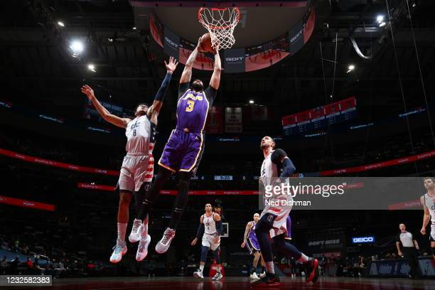 Anthony Davis of the Los Angeles Lakers dunks the ball during the game against the Washington Wizards on April 28, 2021 at Capital One Arena in...