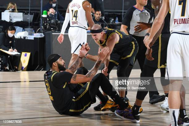 Anthony Davis of the Los Angeles Lakers gets helped up by teammates during Game Two of the Western Conference Finals of the NBA Playoffs on September...