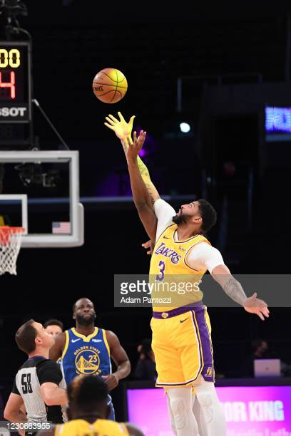Anthony Davis of the Los Angeles Lakers gets the tip off during the game against the Golden State Warriors on January 18, 2021 at STAPLES Center in...