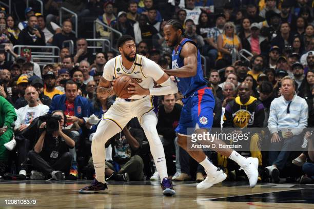 Anthony Davis of the Los Angeles Lakers handles the ball while Kawhi Leonard of the LA Clippers plays defense during the game on March 8 2020 at...