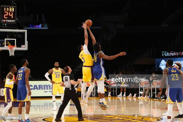 Anthony Davis of the Los Angeles Lakers jumps ball against James Wiseman of the Golden State Warriors on January 18, 2021 at STAPLES Center in Los...