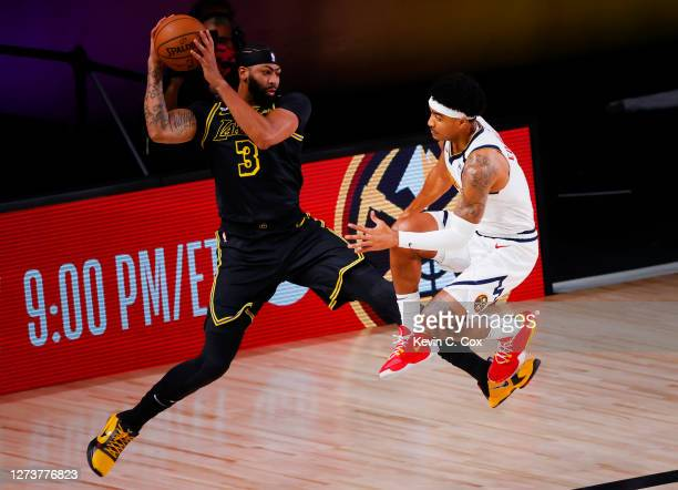 Anthony Davis of the Los Angeles Lakers leaps for a rebound against Gary Harris of the Denver Nuggets during the first quarter in Game Two of the...
