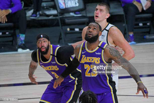 Anthony Davis of the Los Angeles Lakers LeBron James of the Los Angeles Lakers and Nikola Jokic of the Denver Nuggets look to rebound during Game...