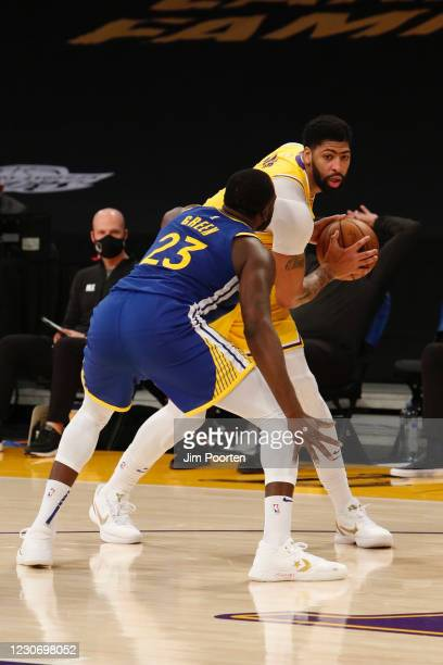 Anthony Davis of the Los Angeles Lakers looks to drive against Draymond Green of the Golden State Warriors on January 18, 2021 at STAPLES Center in...