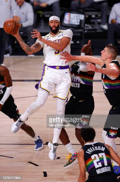 Anthony Davis of the Los Angeles Lakers looks to pass the ball during the first quarter against the Denver Nuggets in Game Three of the Western...