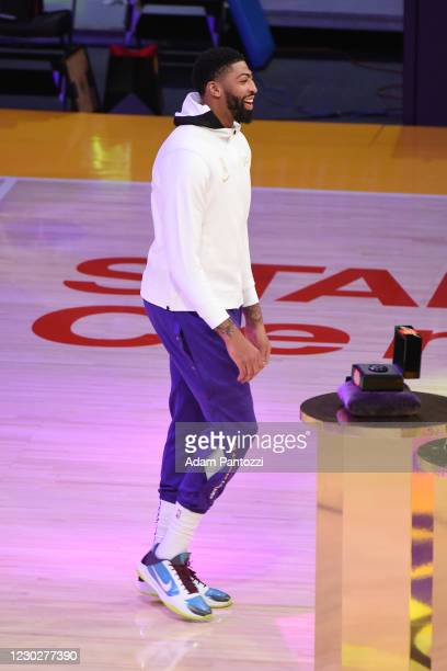Anthony Davis of the Los Angeles Lakers reacts as he gets his 2019-20 NBA Championship ring during the ring ceremony before the game against the LA...