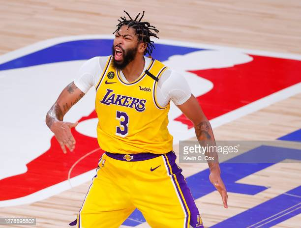Anthony Davis of the Los Angeles Lakers reacts to a three point basket during the fourth quarter against the Miami Heat in Game Four of the 2020 NBA...