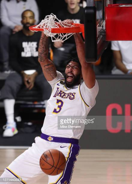 Anthony Davis of the Los Angeles Lakers reacts to his dunk during the first quarter against the Houston Rockets in Game Three of the Western...