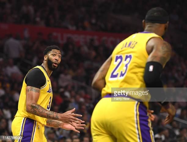 Anthony Davis of the Los Angeles Lakers reacts toward LeBron James during the first half in the LA Clippers season home opener at Staples Center on...