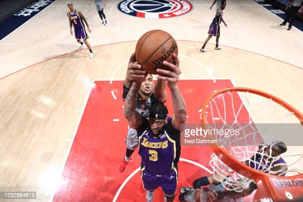 Anthony Davis of the Los Angeles Lakers rebounds the ball during the game against the Washington Wizards on April 28, 2021 at Capital One Arena in...