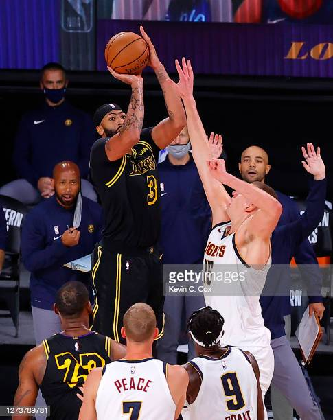 Anthony Davis of the Los Angeles Lakers shoots a three point basket to win the game over Denver Nuggets in Game Two of the Western Conference Finals...