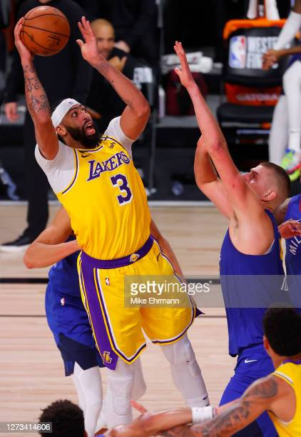 Anthony Davis of the Los Angeles Lakers shoots against Nikola Jokic of the Denver Nuggets during the third quarter in Game One of the Western...