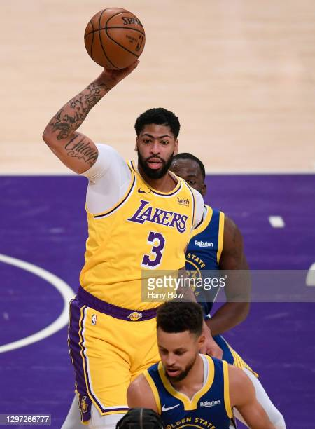 Anthony Davis of the Los Angeles Lakers takes a pass between Stephen Curry and Draymond Green of the Golden State Warriors during a 115-113 loss to...