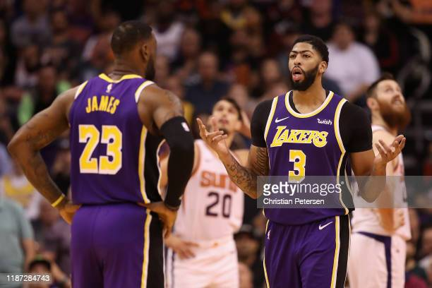 Anthony Davis of the Los Angeles Lakers talks with LeBron James during the second half of the NBA game against the Phoenix Suns at Talking Stick...
