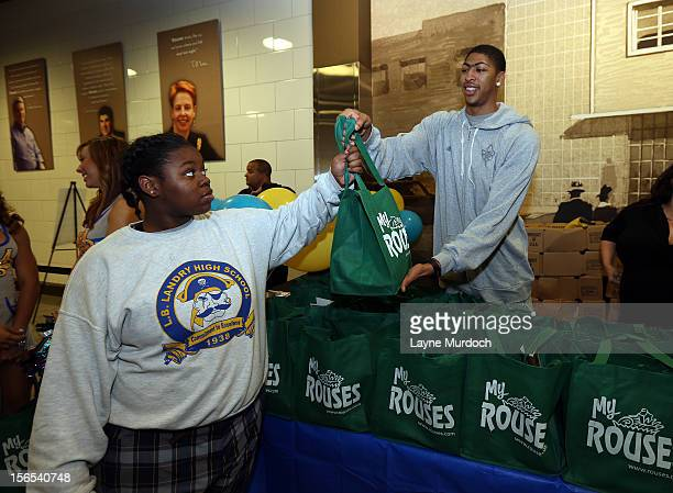 Anthony Davis of the New Orleans Hornets distributes Thanksgiving baskets provided by the Hornets and Rouses to Emerge students on November 15 2012...