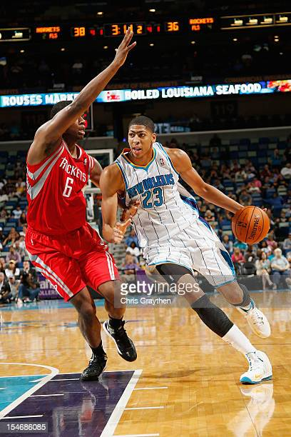 Anthony Davis of the New Orleans Hornets drives the ball around Terrence Jones of the Houston Rockets at New Orleans Arena on October 24 2012 in New...