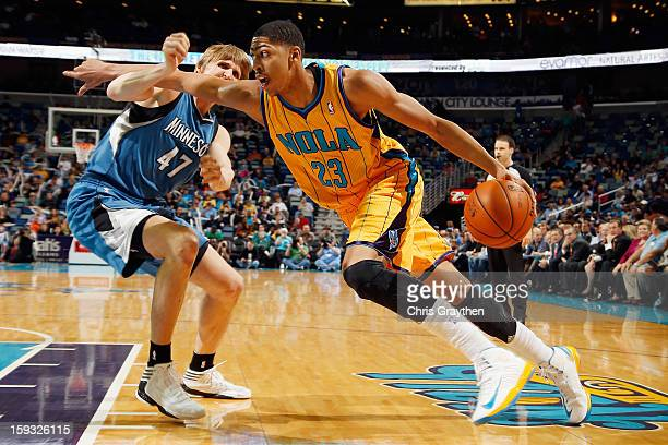 Anthony Davis of the New Orleans Hornets drives the ball around Andrei Kirilenko of the Minnesota Timberwolves at New Orleans Arena on January 11...