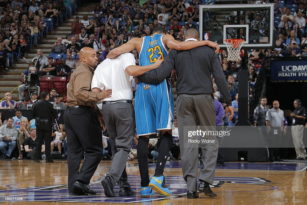 Anthony Davis #23 of the New Orleans Hornets gets help off the court in the fourth quarter against the Sacramento Kings on April 10, 2013 at Sleep Train Arena in Sacramento, California.