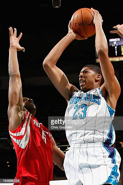 Anthony Davis of the New Orleans Hornets shoots the ball over Terrence Jones of the Houston Rockets at New Orleans Arena on October 24 2012 in New...