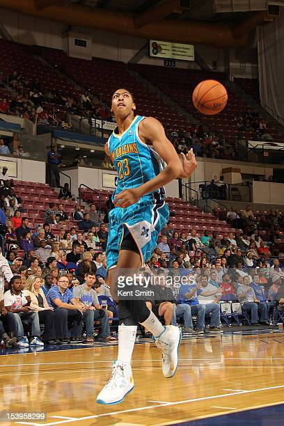 Anthony Davis of the New Orleans Hornets takes a shot behind his back during the game against the Charlotte Bobcats at the North Charleston Coliseum...