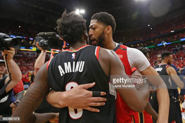 Anthony Davis of the New Orleans Pelicans and AlFarouq Aminu of the Portland Trail Blazers greet each other after the game in Game Four of Round One...