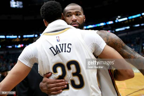 Anthony Davis of the New Orleans Pelicans and DeMarcus Cousins of the New Orleans Pelicans hug after defeating the Memphis Grizzlies 111 104 after a...