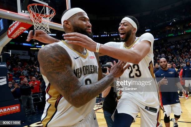 Anthony Davis of the New Orleans Pelicans and DeMarcus Cousins of the New Orleans Pelicans celebrate after defeating the Chicago Bulls 132 128 in...